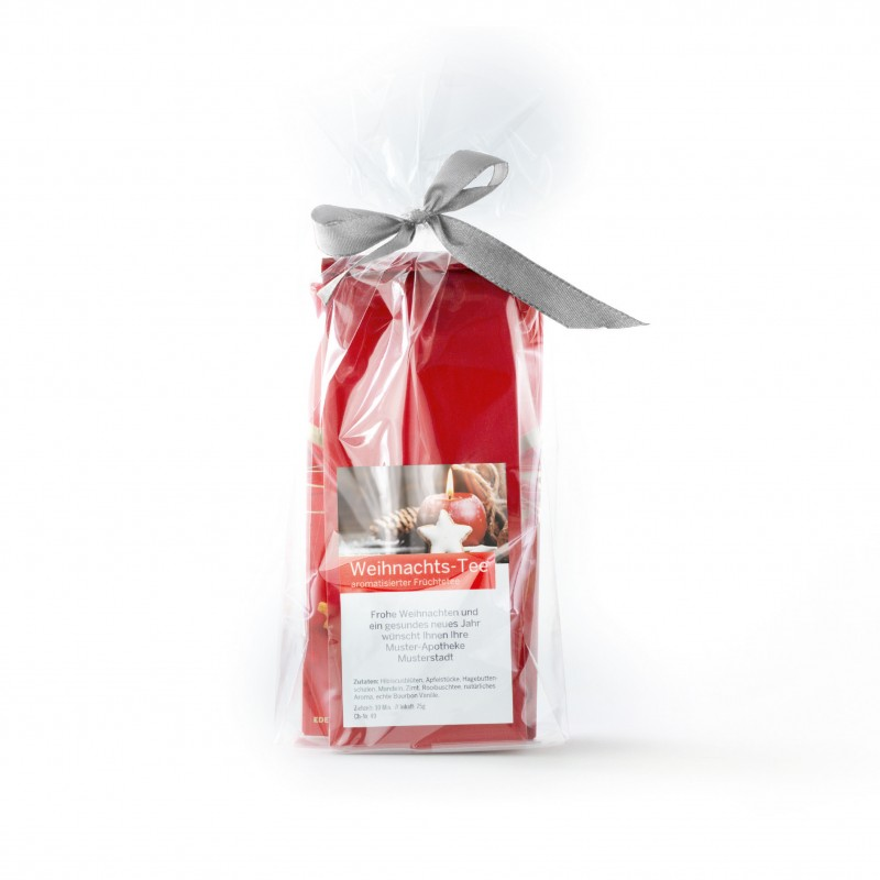 Geschenkpackung mit Weihnachtstee und 3 Kandissticks
